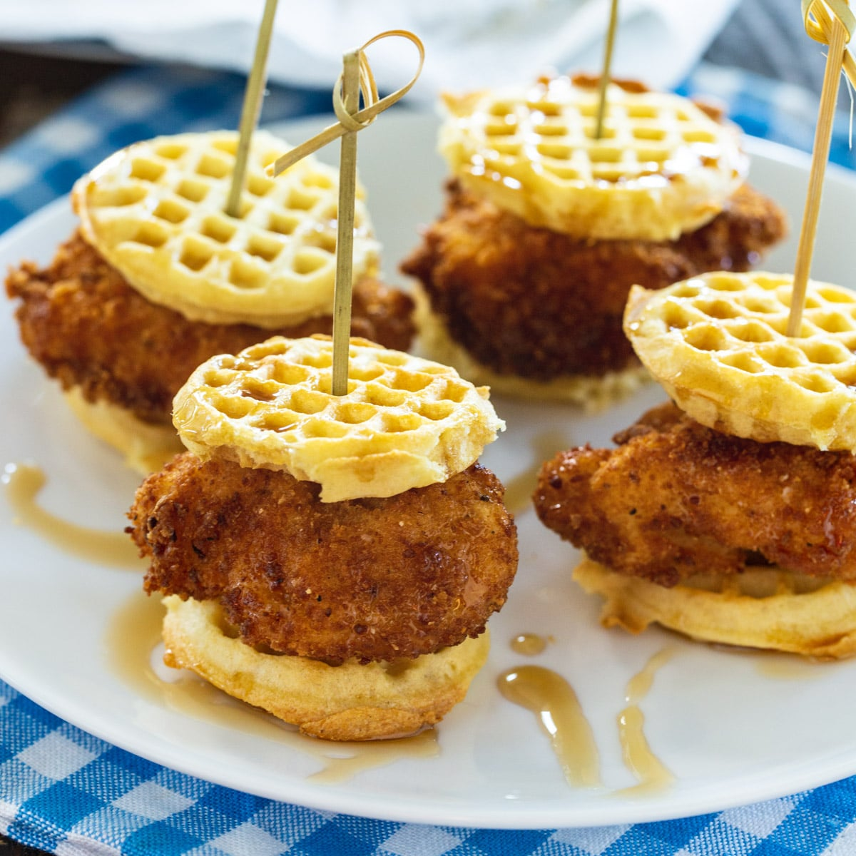 Four Chicken and Waffle Sliders on a plate.