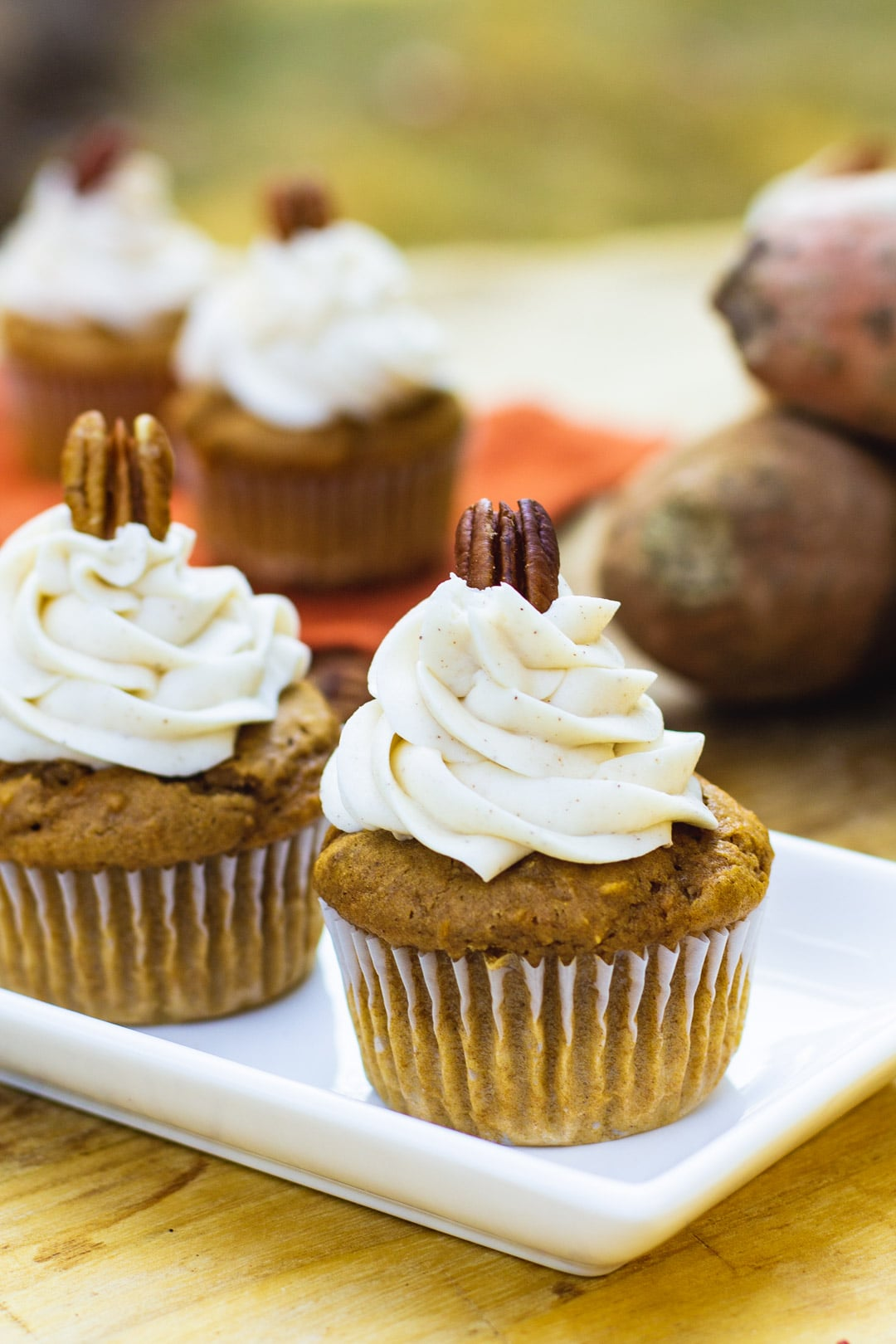 Sweet Potato Cupcakes with Spiced Buttercream on a white serving tray.