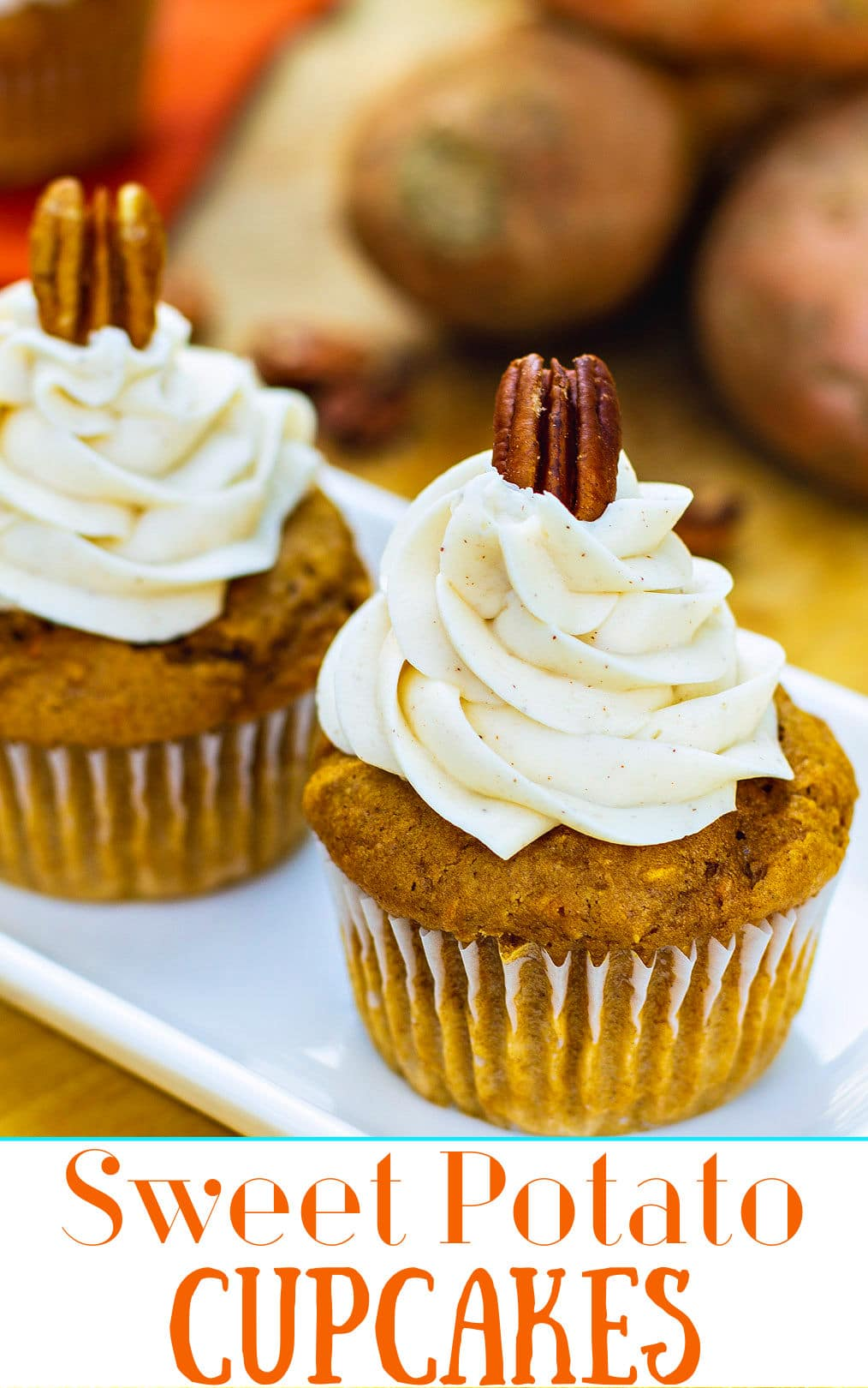 Close-up of cupcake with frosting topped with a pecan.