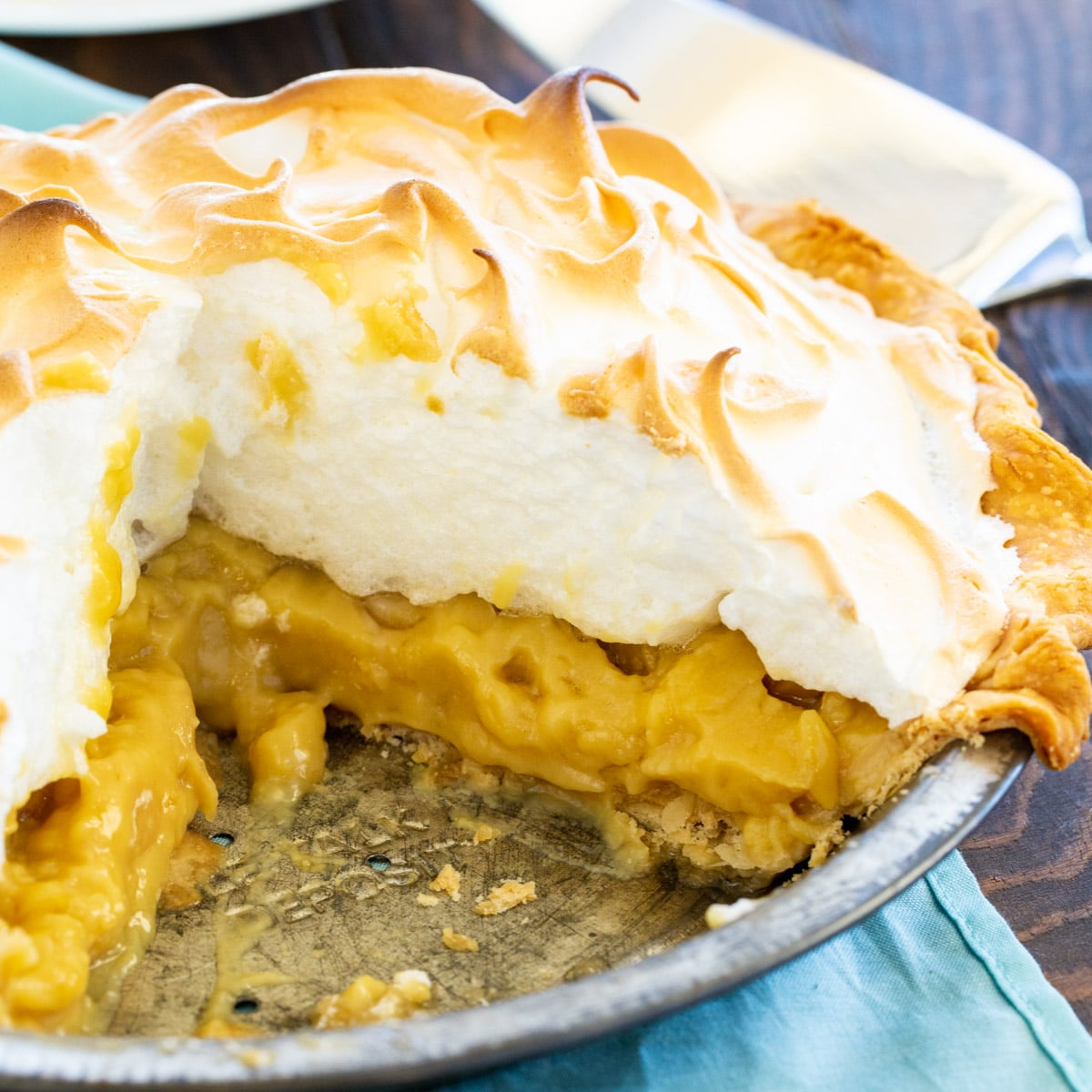 Butterscotch Pudding Pie with a slice cut out.