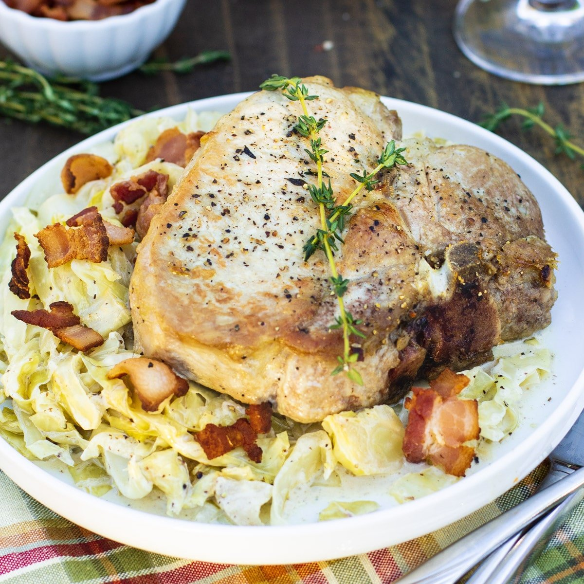 Pork Chops and Creamy Cabbage on a plate.