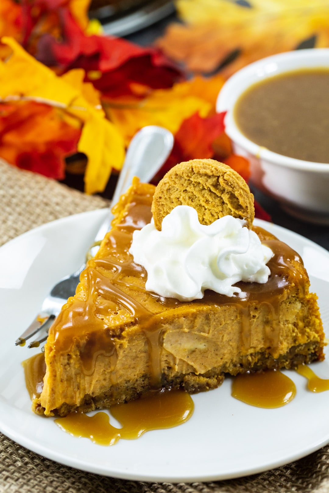 Slice of Pumpkin Cheesecake on a plate.