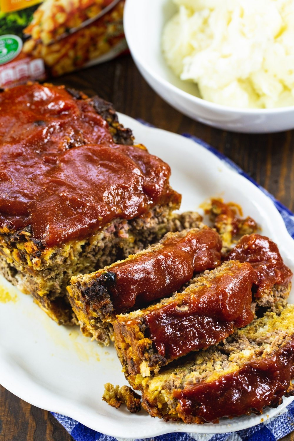 Stove Top Meatloaf cut into slices on a serving platter.