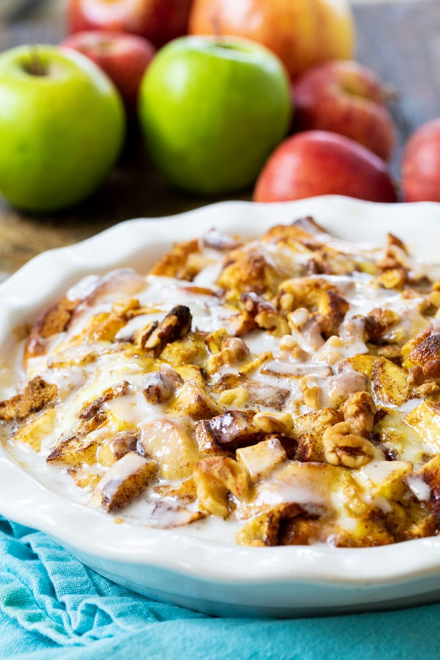 Cinnamon Roll Bake with apples in background.