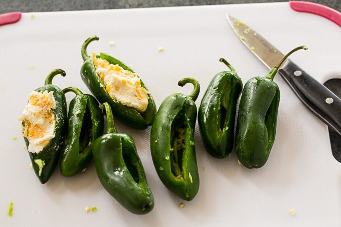 Stuff the jalapenos with cream cheese