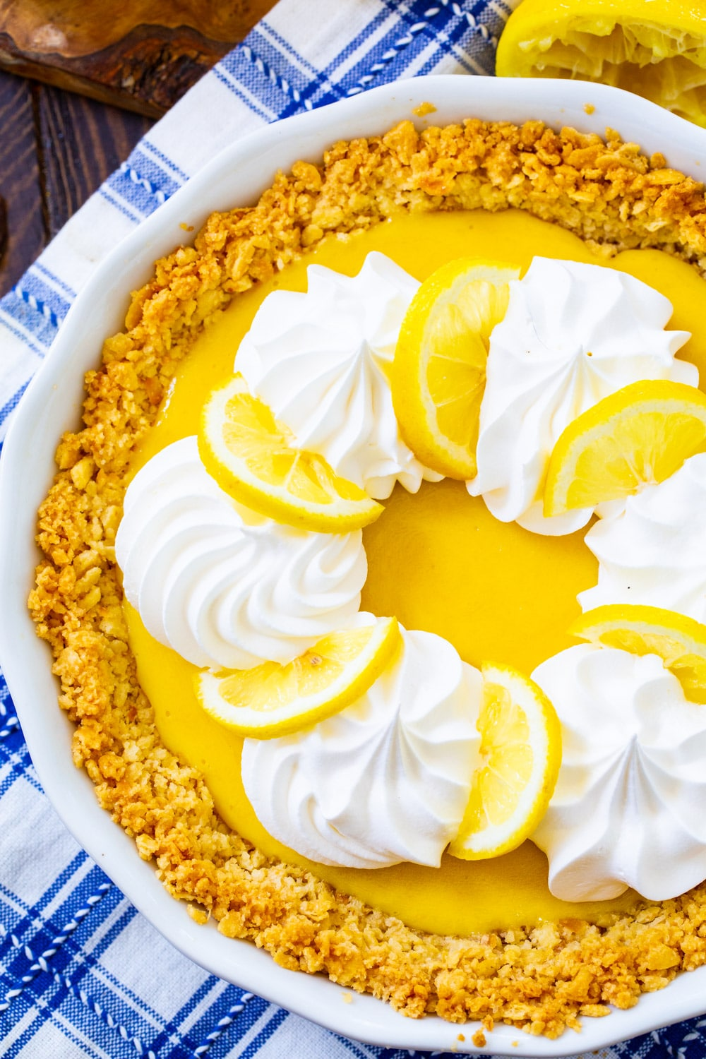 Whole pie topped with whipped cream and lemon slices.