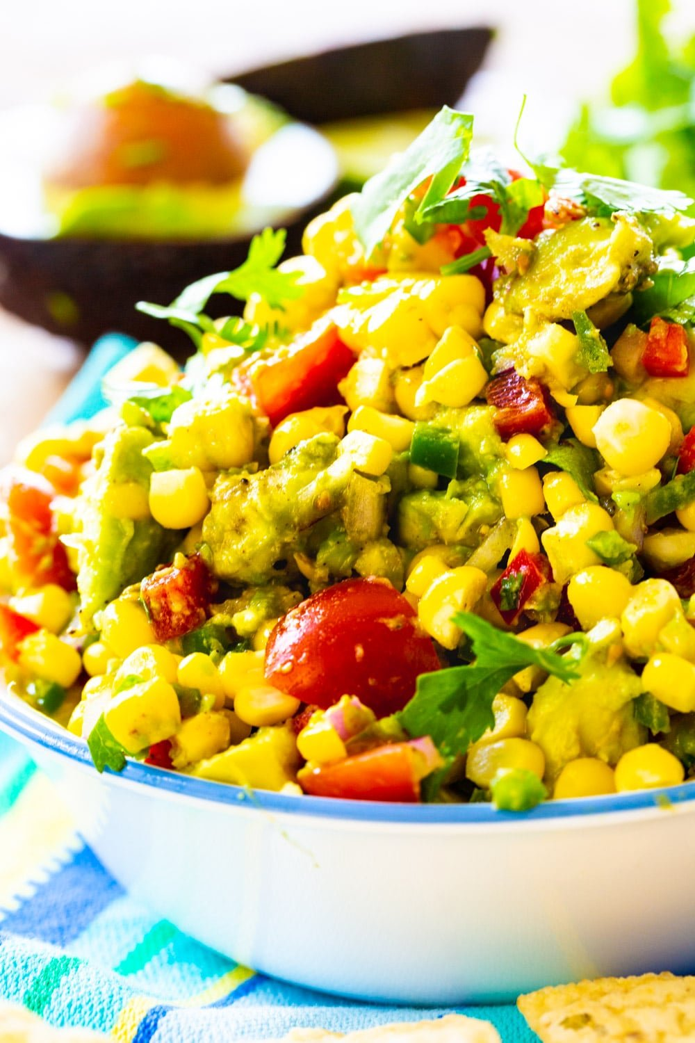 Avocado and Corn Salsa piled high in a bowl.