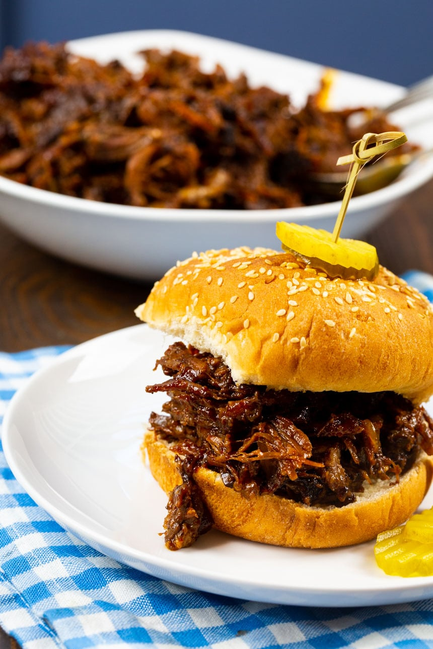 BBQ Beef Sandwich with bowl full of shredded beef.