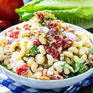 Pasta Salad with bacon, lettuce, and tomato in a white bowl.