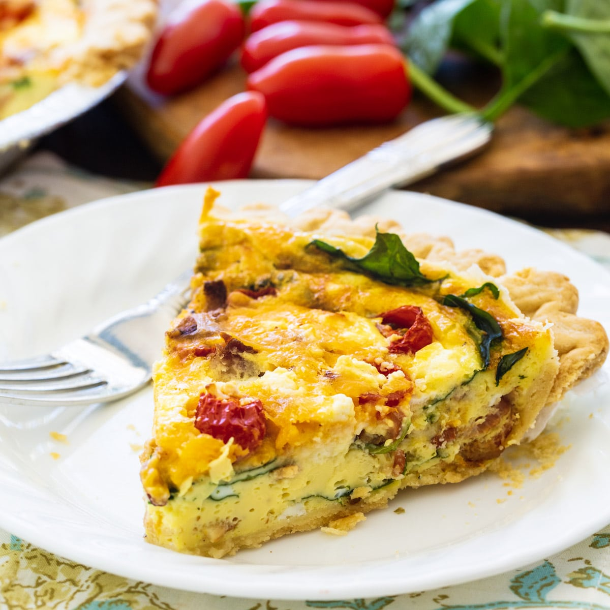Slice of BLT Quiche on a plate.