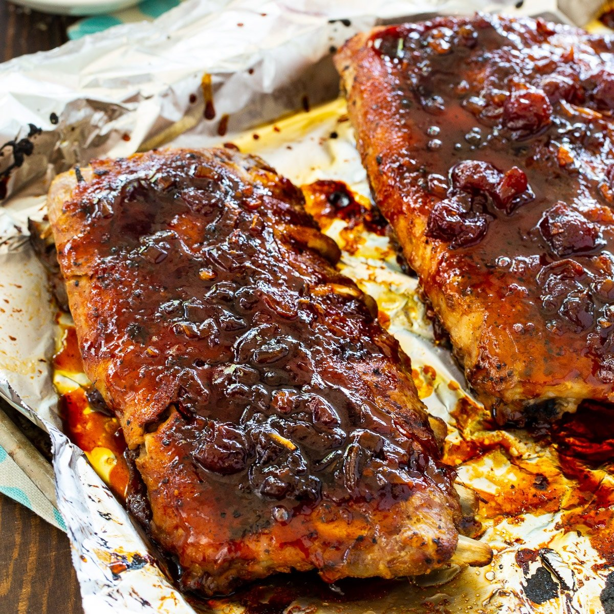 Ribs covered with glaze on a baking sheet.