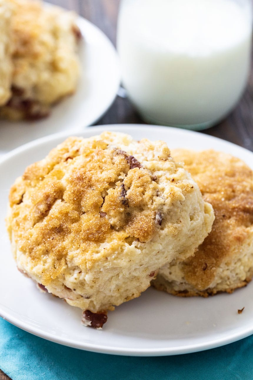 Brown Sugar Bacon Biscuits on a plate with buttermilk in background