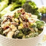 Broccoli Salad with Bacon and Blue Cheese in a white bowl.