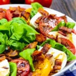 Bacon Caprese Salad on a large white plate.