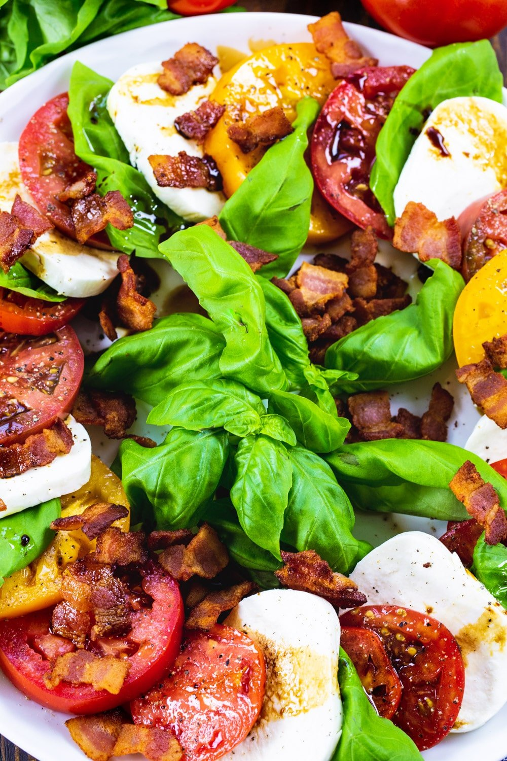Overhead of Caprese Salad with Bacon on a large serving plate.