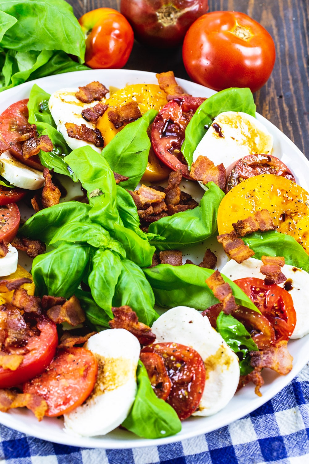 Bacon Caprese Salad on white serving plate.