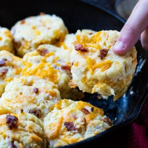 Hand picking up a Bacon Cheddar Biscuit.