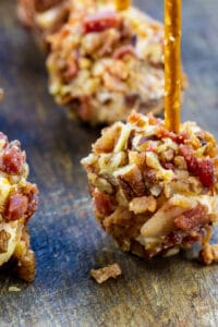 Bacon Cheese Ball Bites with pretzels stuck in them.