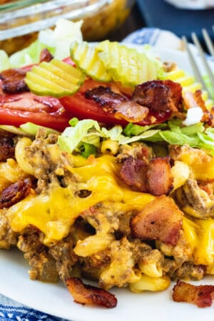 Bacon Cheeseburger Casserole with shredded lettuce and tomato on a plate.