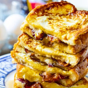 Bacon Stuffed French Toast stacked on a plate.