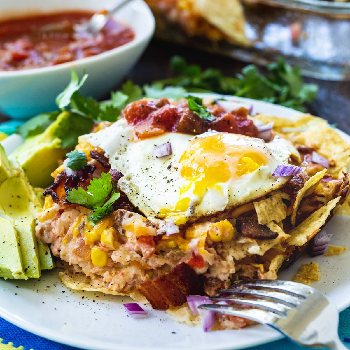 Bacon and Egg Chilaquiles on a plate.