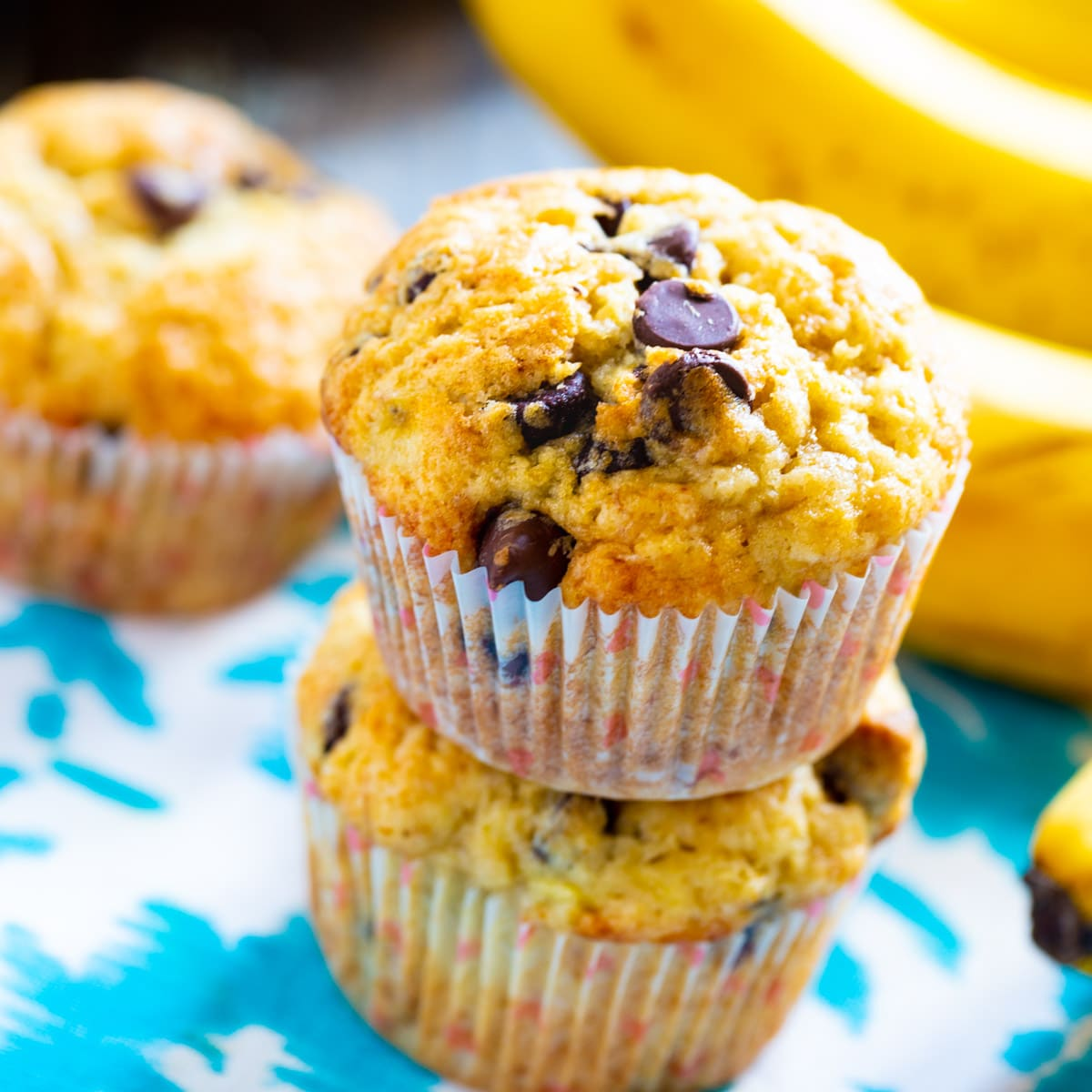 Two Banana Chocolate Chip MUffins stacked on top of each other.