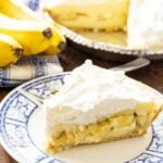 Slice of Banana Cream Pie on a blue and white plate