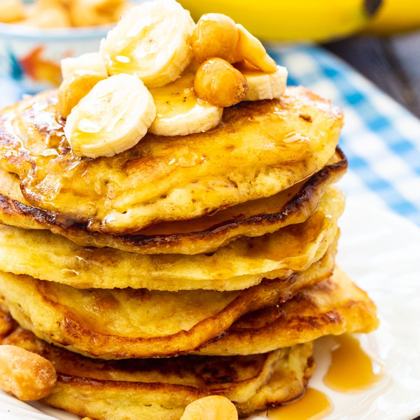 Stack of Macadamia Nut Banana Pancakes on a white plate