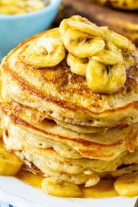 Stack of Banana Pancakes with Caramel Syrup on a plate.