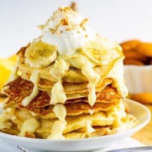 Banana Pudding Pancakes stacked on a plate.