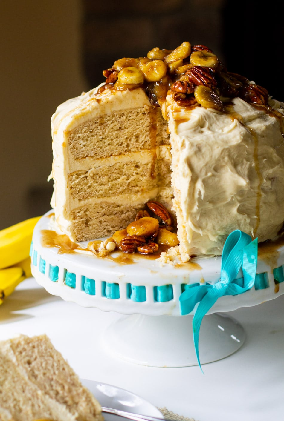 Bananas Foster Cake on cake stand.