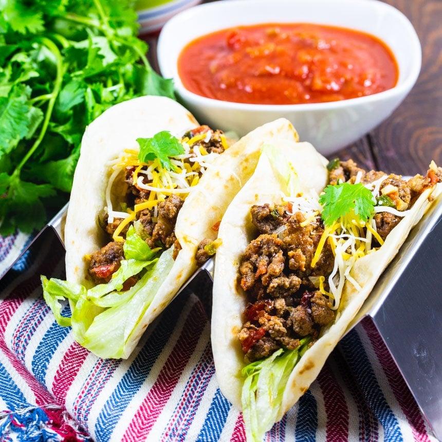 Two tacos in flour tortillas.