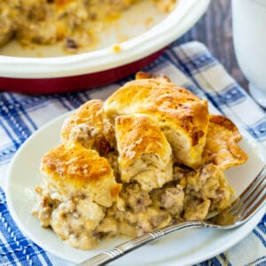 Slice of Biscuits and Gravy Pie on a plate.