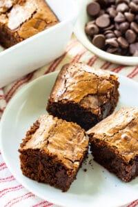 Three Bittersweet Chocolate Brownies on a plate.