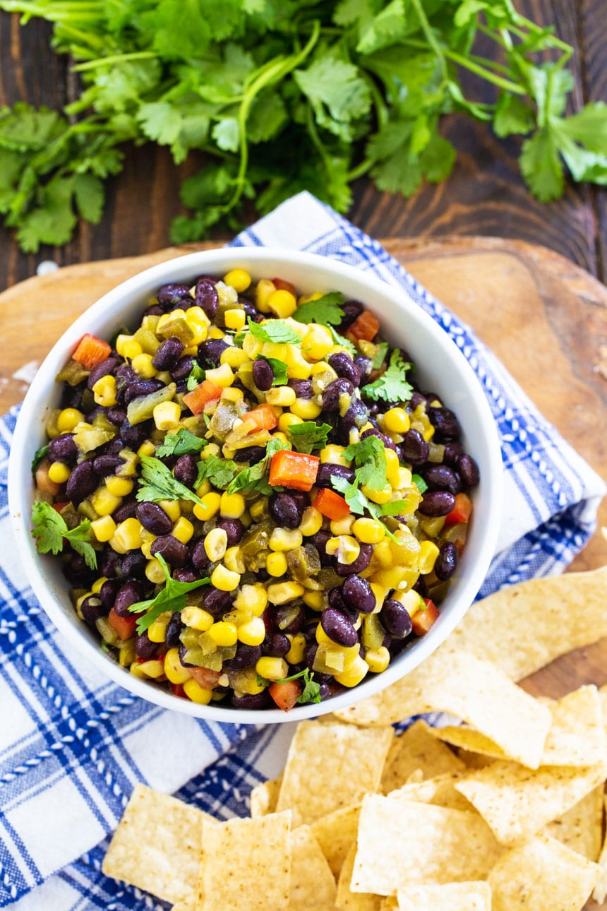 overhead shot of Black Bean and Corn Salsa with tortila chips and fresh cilantro