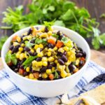 white bowl filled with Corn and Black Bean Salsa