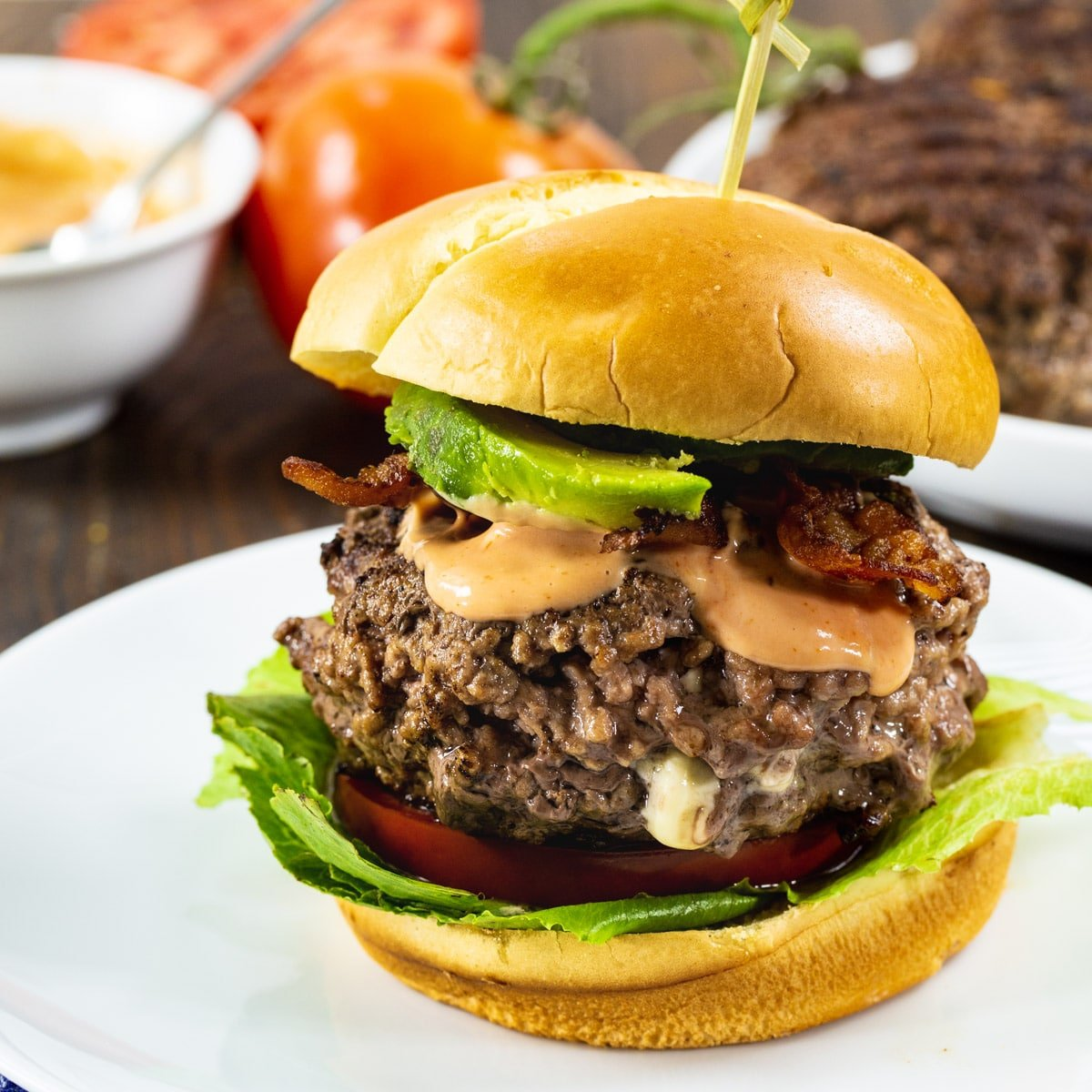 Black and Blue Burgers on toasted brioche buns with bacon and avocado.