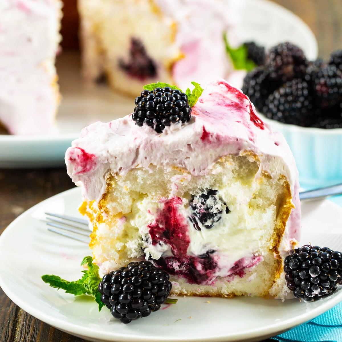 Slice of Blackberries and Cream Angel Food Cake on a plate.