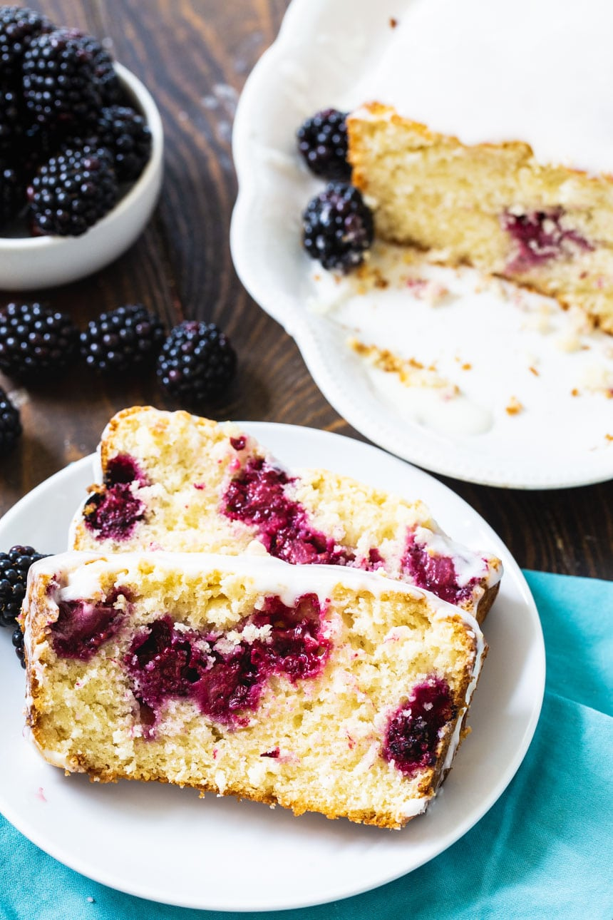 2 slices of Blackberry Buttermilk Loaf Cake on a plate