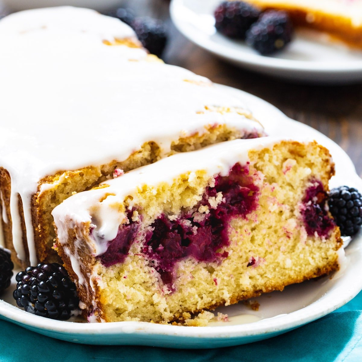 Blackberry Buttermilk Loaf Cake with a slice cut.