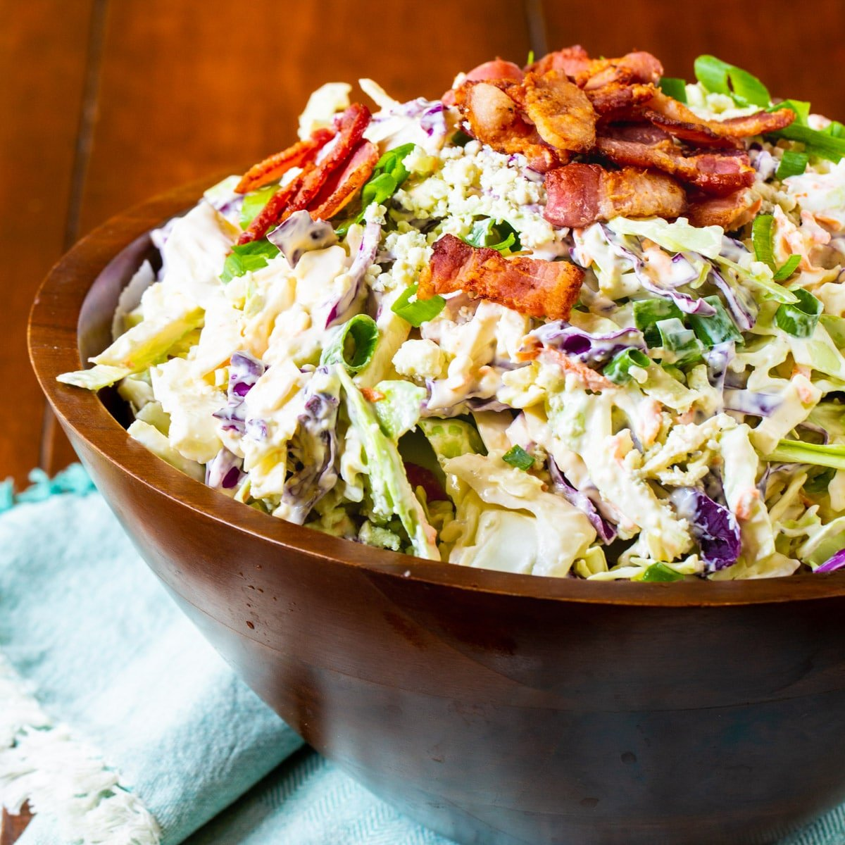 Blue Cheese Bacon Coleslaw in a large wooden bowl.