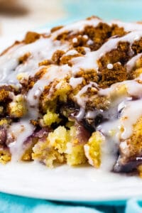 slice of blueberry coffee cake on a plate.