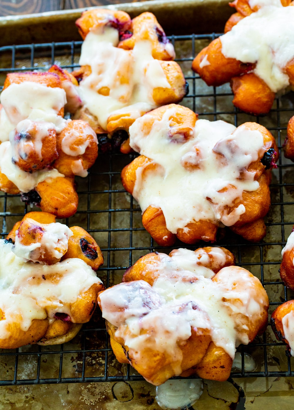 Blueberry Fritters with Browned Butter Glaze on a rack.