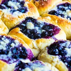Blueberry Kolaches on a baking tray.