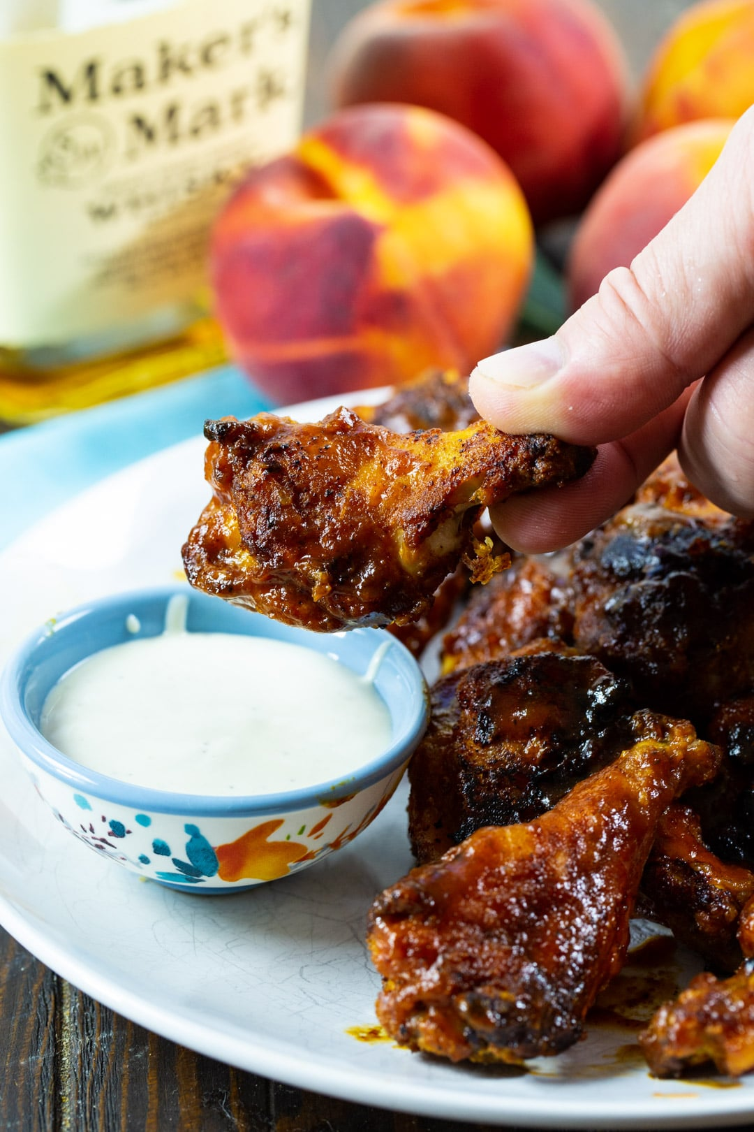 Wing getting dipped in ranch dressing dip.