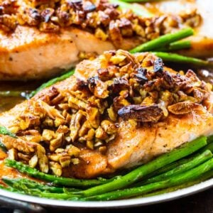 Bourbon-Pecan Glazed Salmon in a pan with asparagus