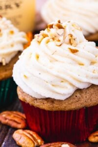 Bourbon ans Spice Cupcakes surrounded by pecan halves.