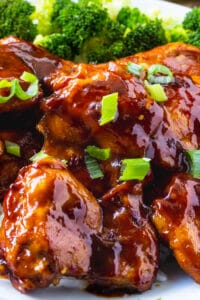 Teriyaki Chicken topped with green onions on a aplet.