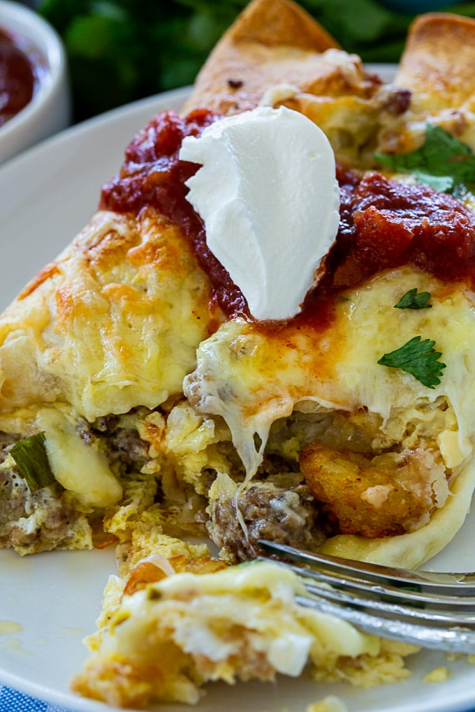 Breakfast Enchiladas with sour cream and salsa