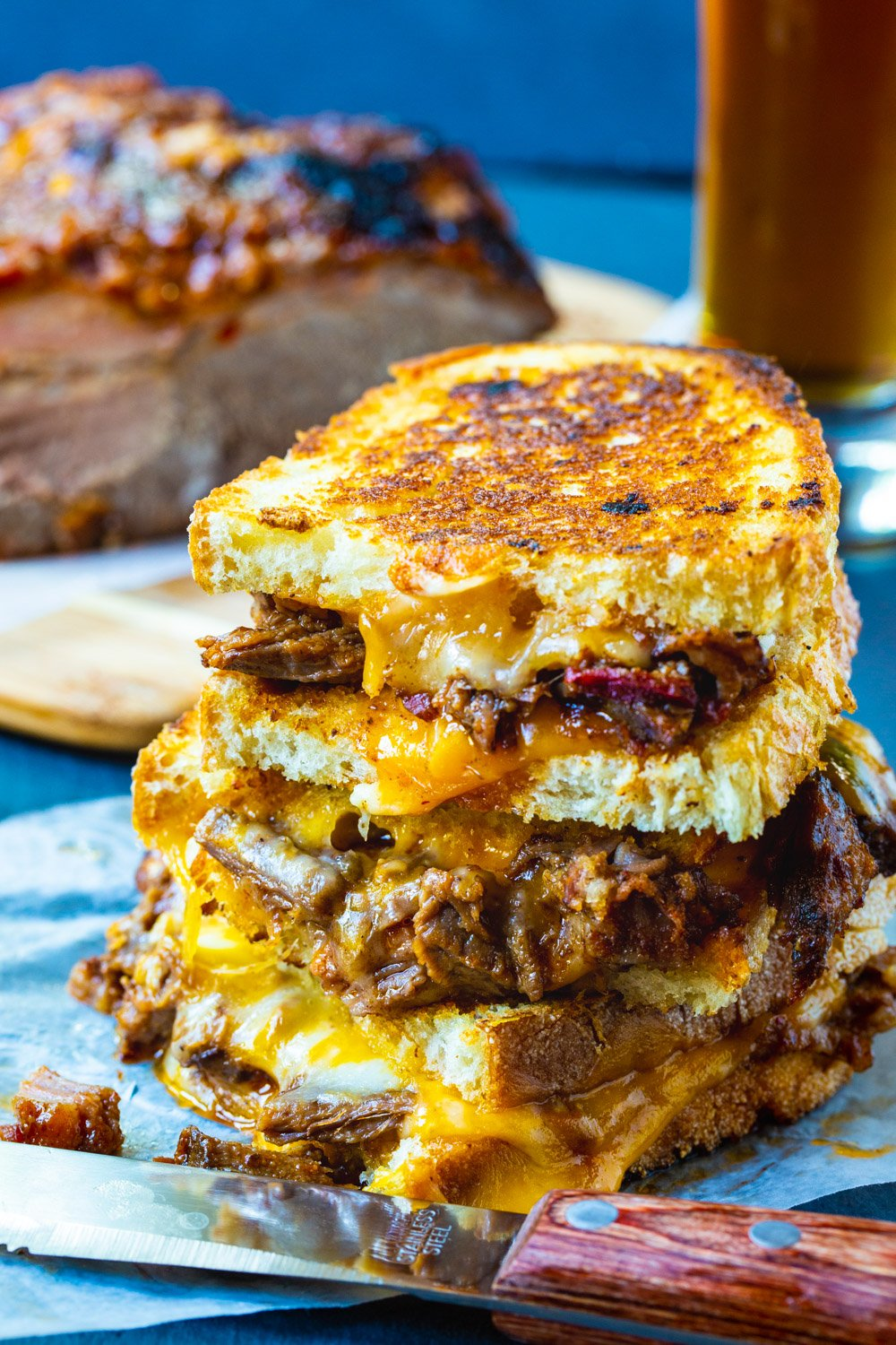Brisket Grilled Cheese stacked on top of each other.